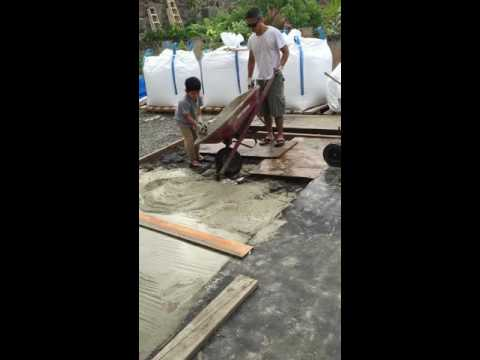 Pouring concrete pad for patio