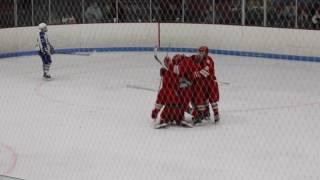 Angelo Morace scores for East Longmeadow High School hockey