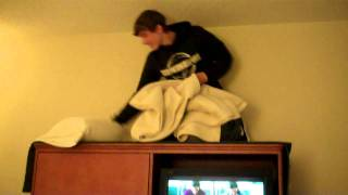 Cody Burk Sleeps ontop of a tv entertainment center at a hotel!