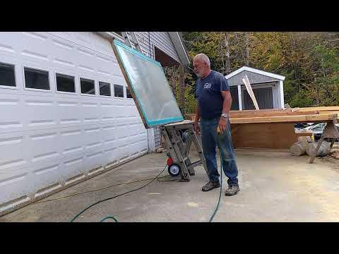 Plate glass window falling off ladder