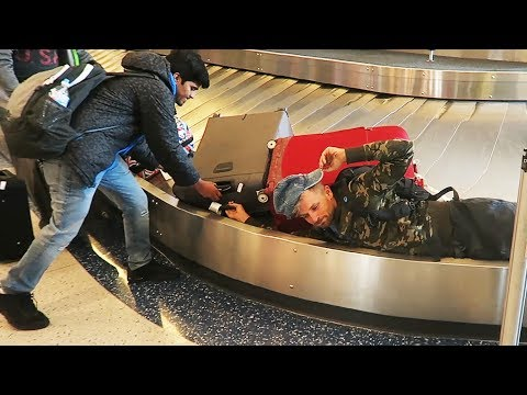 Man Falls in Airport Carousel Reaching for Luggage!