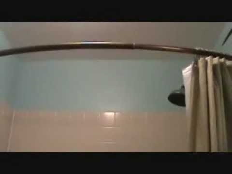 Installing a curved shower curtain rod