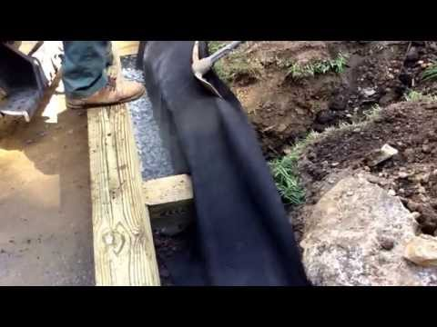 Landscape Networker | Tips and ideas on how to install a railroad tie retaining wall.