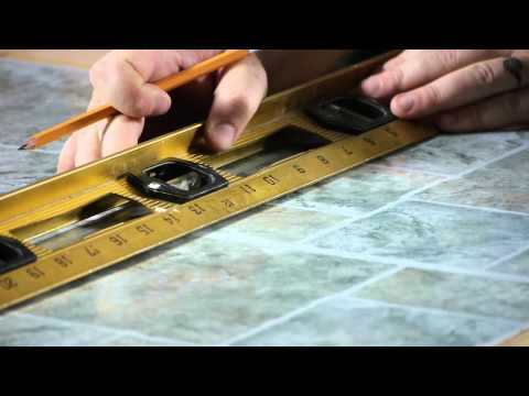 How to Install Self-Adhesive Floor Tiles on Top of Old Tiles : Working on Flooring