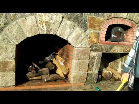 Preferred Properties landscape and masonry staff excells on the outdoor Fireplace with pizza oven