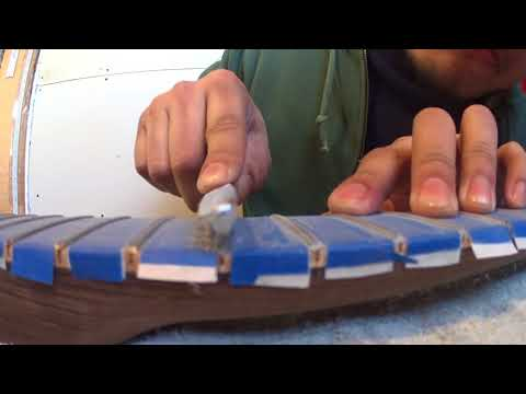Guitar fret leveling and re-crowning