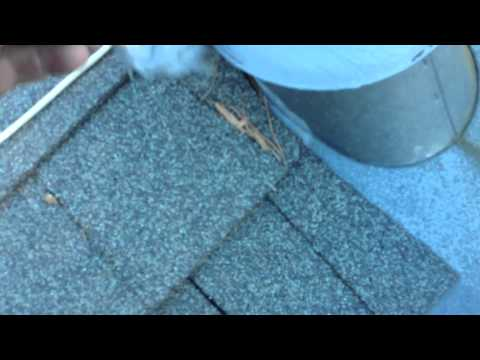 ROOFING:SEALING A FLASHING.