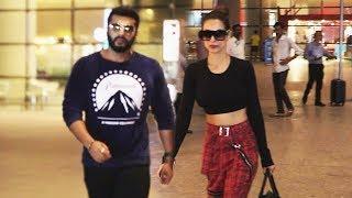 Divorce के बाद, खुले में घूम रहे है Malaika और Arjun Kapoor - देखिये Airport का Video