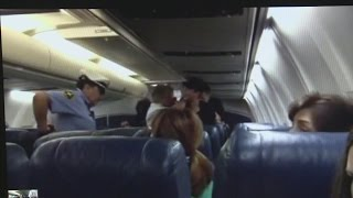 NM woman arrested for punching flight attendant