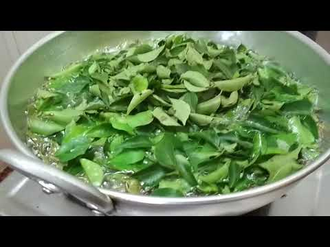 Homemade Herbal hair oil with Mehndi (Marudhani in Tamil) and Curry leaves extract