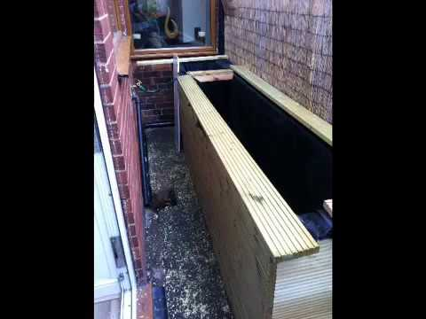 How to build a raised wooden pond