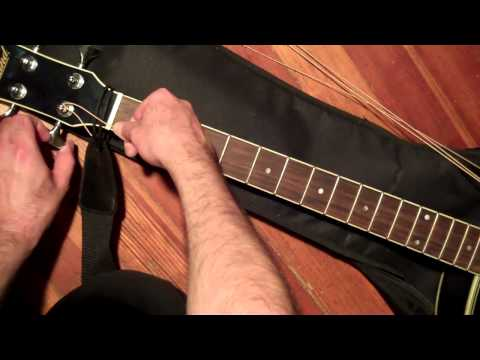How To Put New Strings On An Acoustic Bass Guitar And Tune It !
