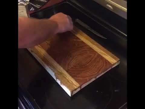 End grain Mesquite cutting board with quarter-sawn Oak sides.