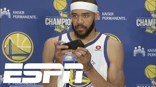 JaVale McGee takes pictures during news conference | ESPN