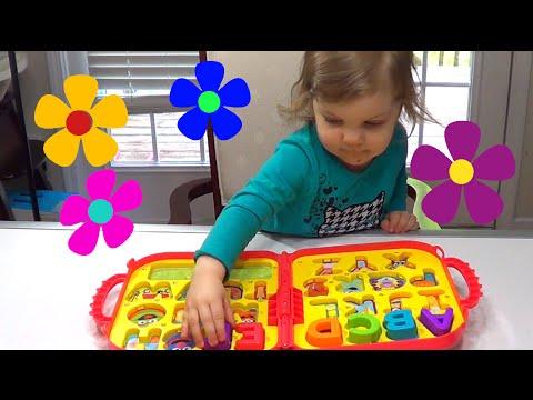 Genevieve Helps Teach Kids their ABC's with Elmo's on the Go Letters Toy Alphabet!