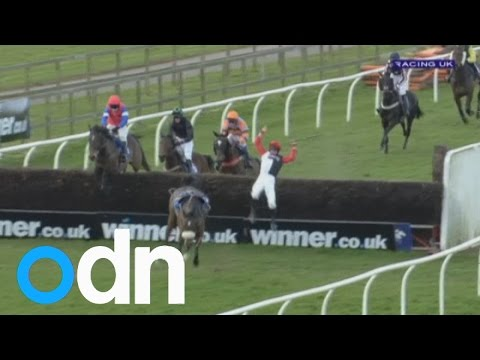 This jockey walks away from a spectacular somersaulting fall