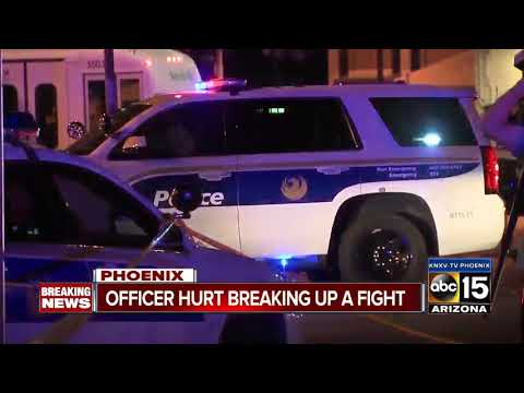 Phoenix officer hurt trying to break up a fight