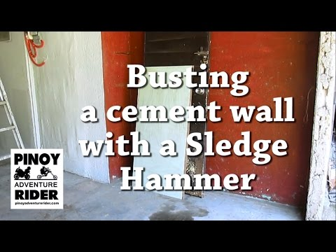 Breaking a Cement Wall with a Sledge Hammer
