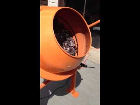Cleaning coins in a cement mixer.