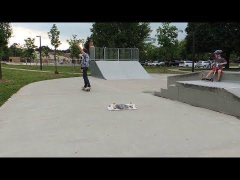 Helping Jacquie progress through the skateboarding basics