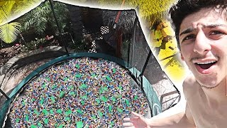 DIVING INTO TRAMPOLINE FILLED WITH 50,000 LEGOS! (I GOT INJURED)