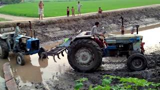 Tractor Pulling through canal mud in Punjab