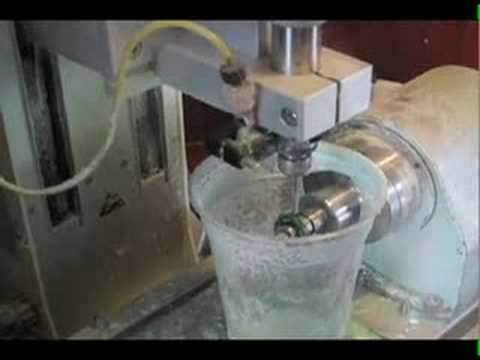 Machine making a wax mold of a ring