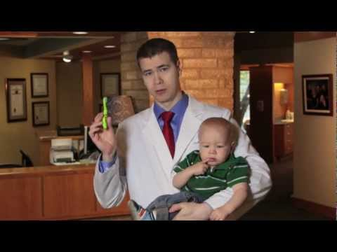 Brushing A Baby's Teeth - Dr. Aaron D. Johnson