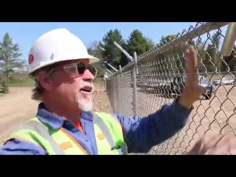 How to use fence hangers to hold up chain link fabric
