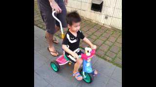 Alfran Riding On The Tricycle
