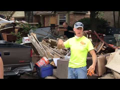 VMware volunteers help family in Houston Texas whose home had been flooded by Hurricane Harvey