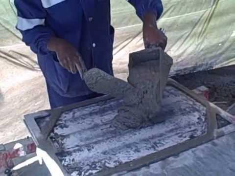 Bebita & Ewape making micro-concrete roof tiles in Zambia -- Build It International