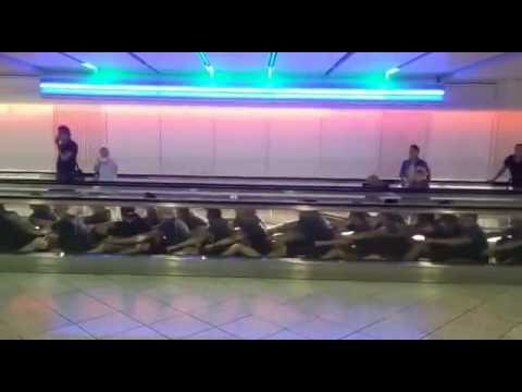 Escalator Airport Rowing