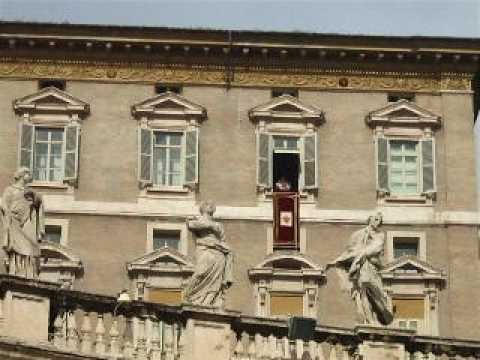 The Pope gives final sign of the Cross blessing before leaving the window