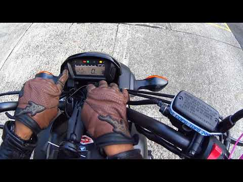 How to adjust the clock and brightness on a Honda CTX700