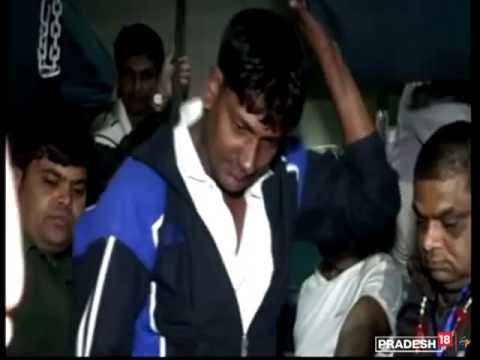 Passengers fight each other for a seat on a train in Agra