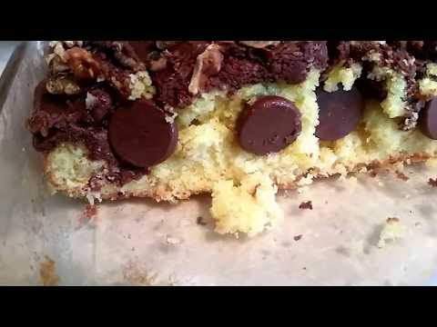 Yellow Cake With Chocolate Frosting And Chocolate Chips And Walnuts