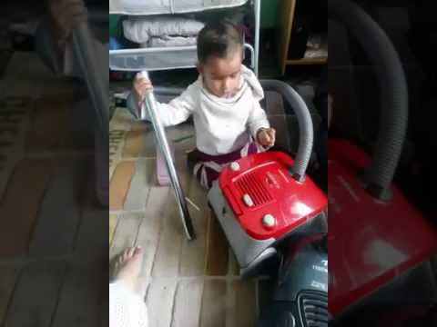 baby playing with vacum cleaner