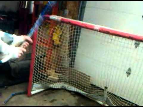 broken hockey stick off a shot