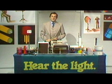 Bell Labs' Henry Feinberg Demonstrates Ways of Using Light to Transmit Sound Waves, 1978