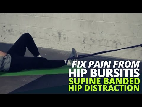 Exercise to Fix Pain from Hip Bursitis - Supine Banded Hip Distraction