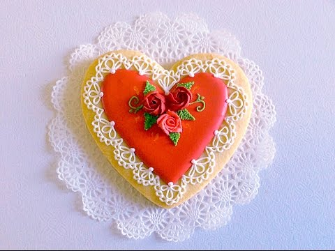 Lace heart cookie with icing roses.