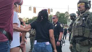 Video shows altercation between Hoover police and protesters.