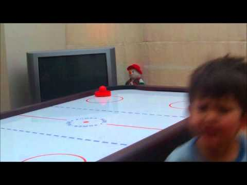 FUNNY VIDEO JOE GETS HIS FINGERS WHACKED BY AIR HOCKEY PUC