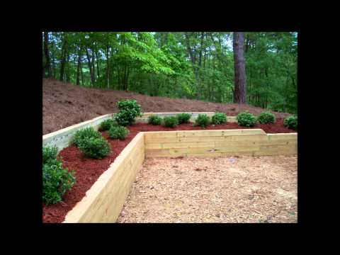 Bennett Landscape, Inc. - Treated Timber Retaining Wall & Planting - Before & After Pictures