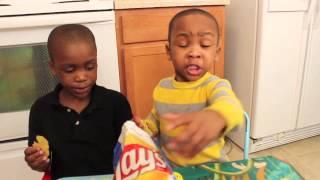 Zay Zay & Jojo tasting Chicken and Waffles flavored chips