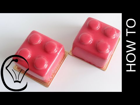 Shiny Red Mirror Glaze Lego Mousse Brick with Raspberry Sauce Insert by Cupcake Savvy's Kitchen