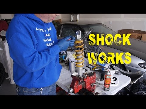 How to disassemble the rear shock on a motorcycle