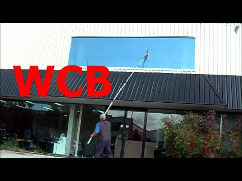 CLEANING HIGH WINDOWS USING SWIVEL SCRUBBER / SQUEEGEE