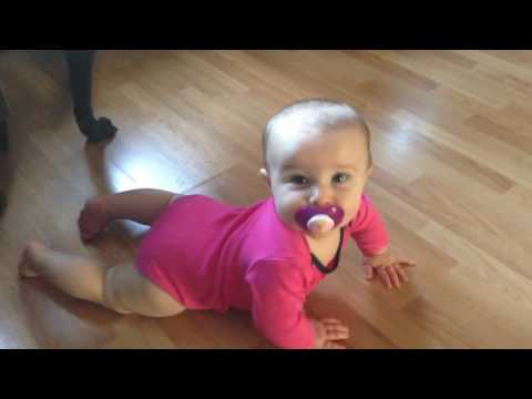 Piper Jean: 7 Months Old, Baby learning to crawl on wood floor